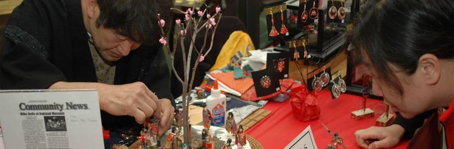 Artist Mikio Sakuma demonstrates his intricate Japanese Paper Craft.
